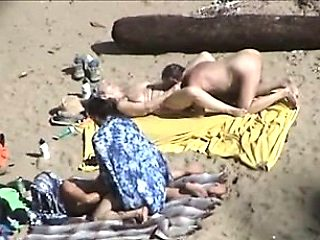 Two Horny Babes Have Group Sex On A Beach