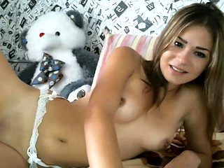 Webcam blonde strips off panties and masturbates