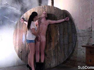 Femdom babe masturbates next to gagged slave