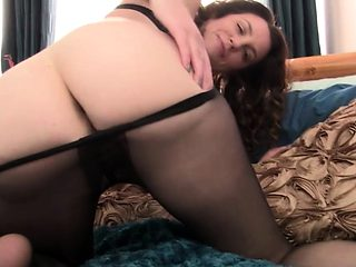 Hot MILF plays with pantyhose
