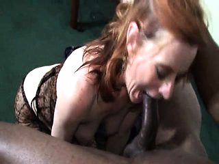 Gorgeous redhead sucks a big cock on pov