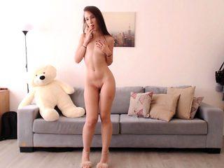 Sexy ass brunette teen does striptease in bedroom