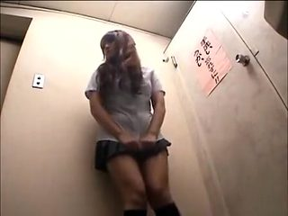 Desperate Japanese girl can't wait to pee!