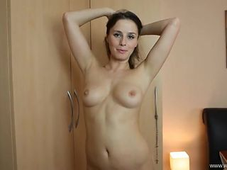 Sensual British beauty strips to show off her titties