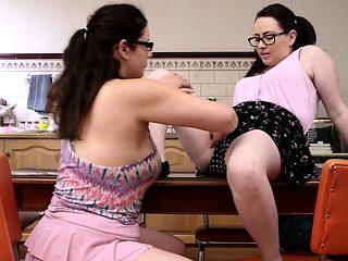 Curvy lesbian hotties fuck in the kitchen