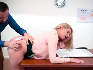 Busty boss is discovered playing in her office