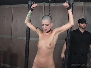 Shaved head girl flogged hard in the dungeon
