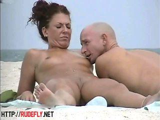 Very horny milf rubbing boobs in nude beach