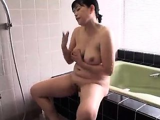 Spying on an Asian girl showering