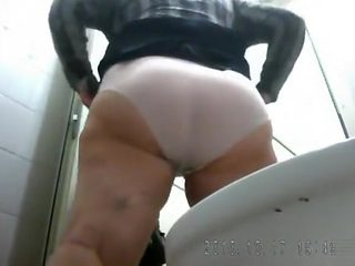 Thick lady is limber as she urinates in voyeur scene