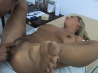 Stacked blonde has a horny doctor thoroughly examining her hairy peach