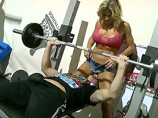 Young buddy finds an amiable sexy MILF training in the same gym with him and asks her to spot for...
