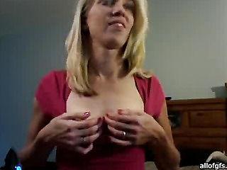 Squeezes her big nipples