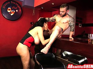 Brunette shemale with big boobs fucking this tattooed guy