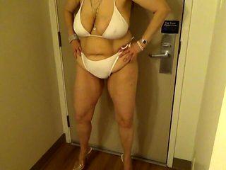 Tinja Stretches A White String Bikini in 6 Inch Stilettos