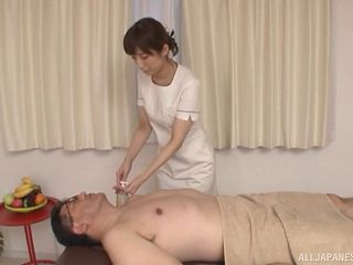 Female masseur from Japan treats the erection of her new customer