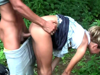 Russian gal in short skirt loves to have sex in the woods