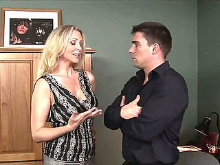 Hot office worker Julia Ann is being seduced and fucked right on her working table by her big bos...