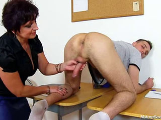 Mature Teacher Gives Her Student A Handjob